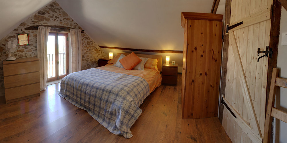 A cosy double room with queen-sized bed just begs you to have an afternoon nap