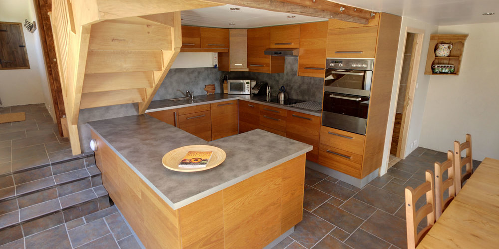 Bleuet has a small but well considered and equipped modern kitchen, without feeling excluded from the rest of the party