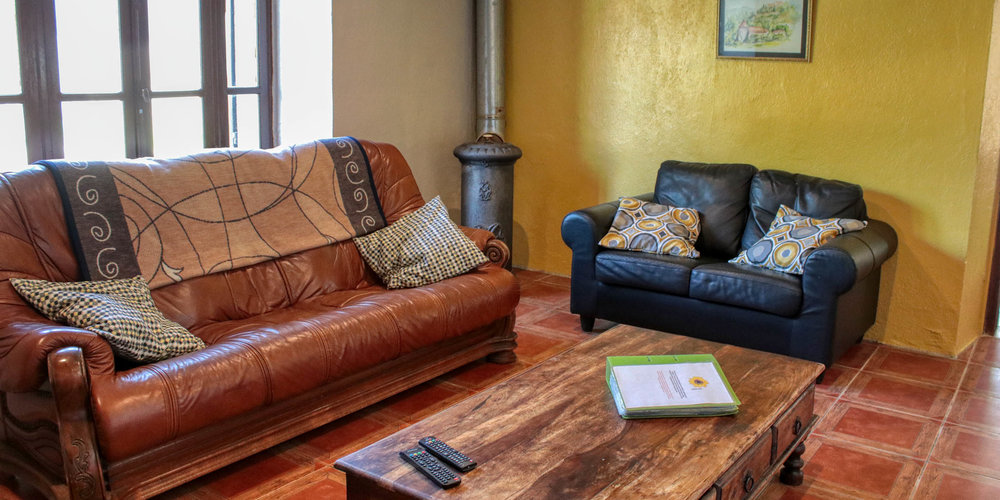 Tournesol's lounge is cool in the summer and cosy in the winter with it's log burning fire