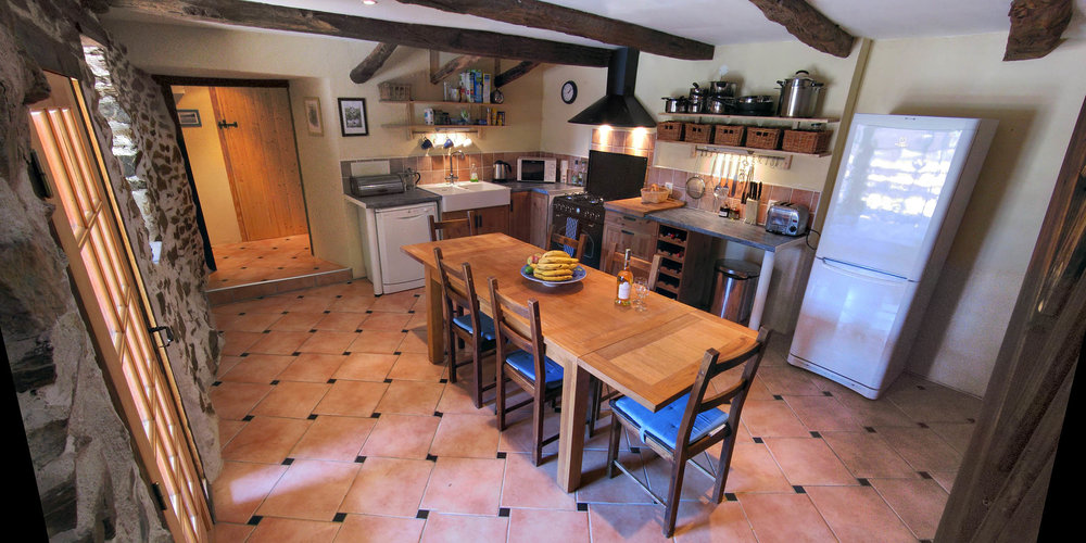 Coquelicot's traditional farmhouse style kitchen is well equipped with modern appliances