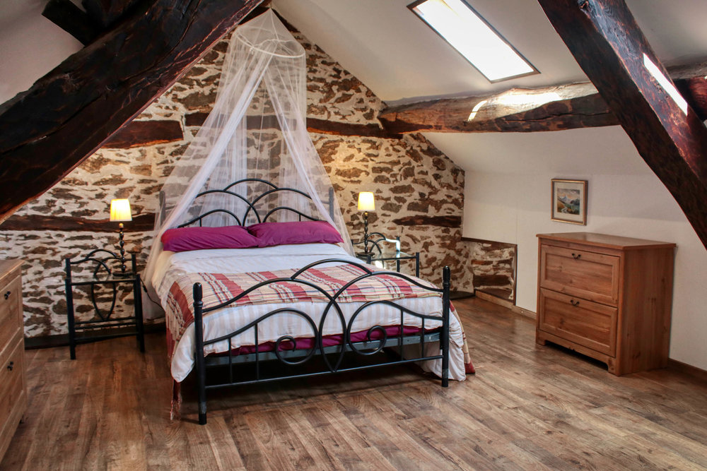 Coquelicot's main bedroom on the second floor is beautiful with plenty of character