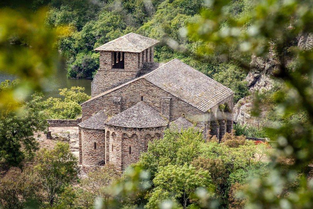 Chapelle de Las Planques through the trees