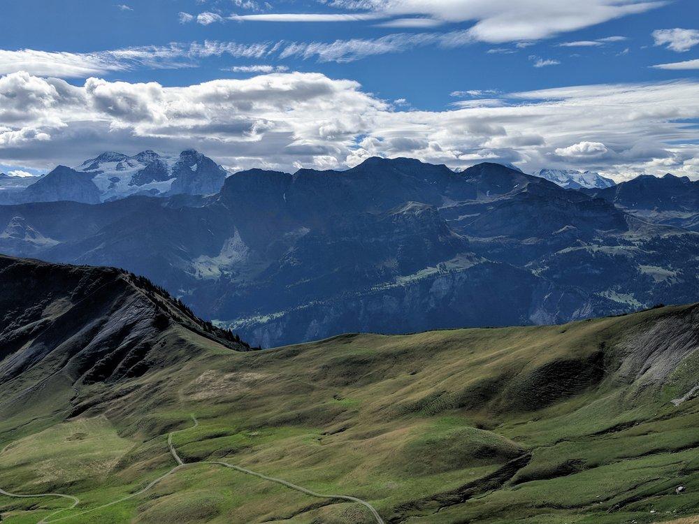 Trail cuts into the rock before descending into Turren