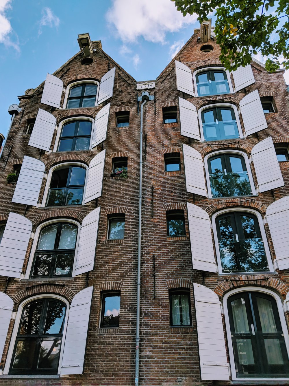Canal houses with huge windows in Amsterdam