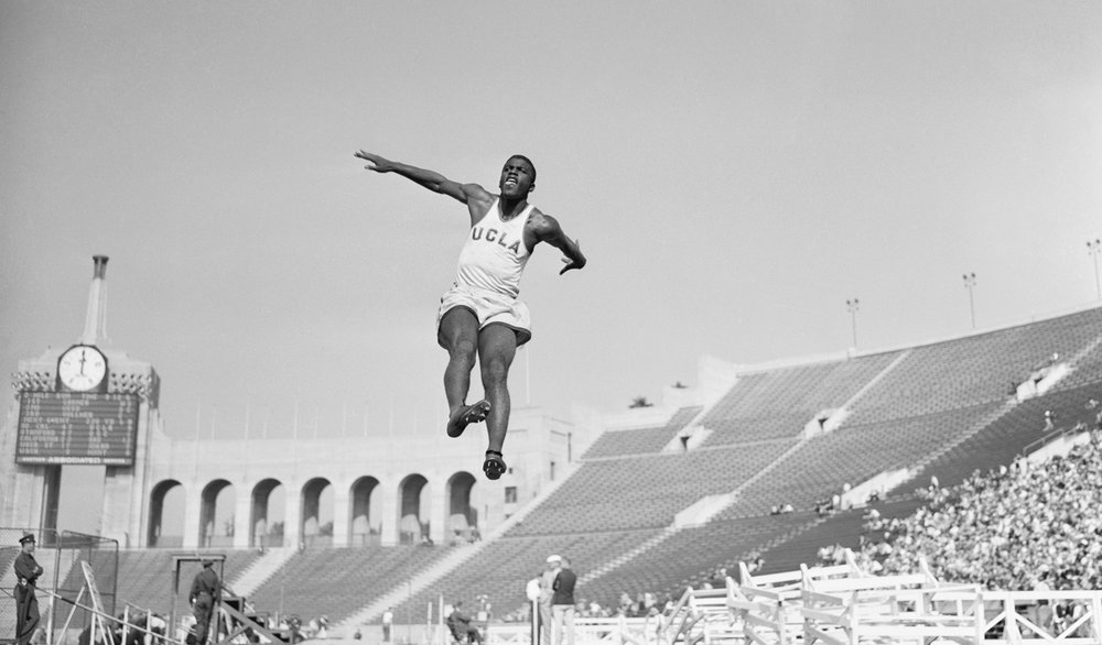 Jackie Robinson competes in the long jump for UCLA , 1940.  Getty Images/Bettman/Contributor