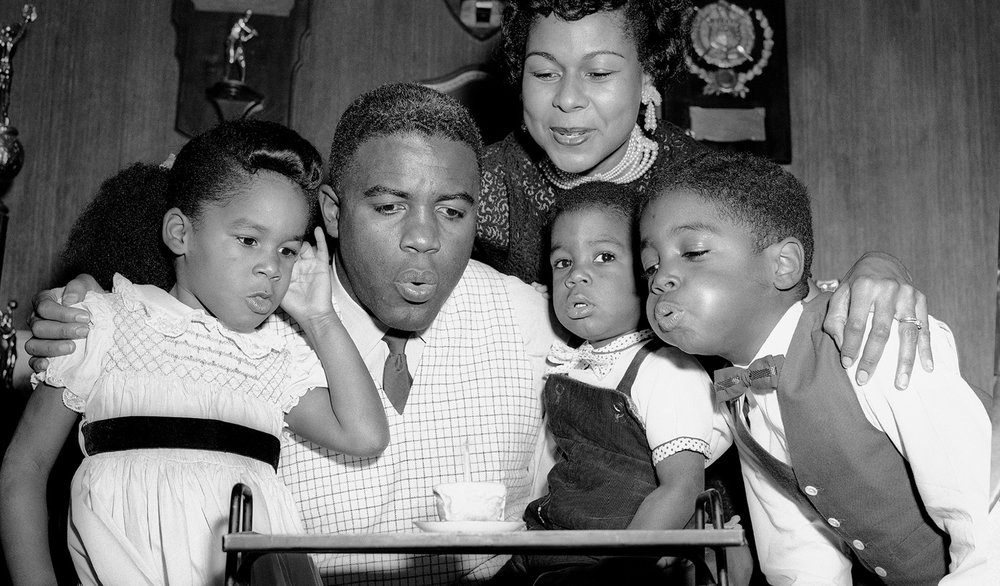 Jackie Robinson celebrates his birthday with wife Rachel Robinson and their children, 1950.  Afro American Newspapers/Gado/Getty Images