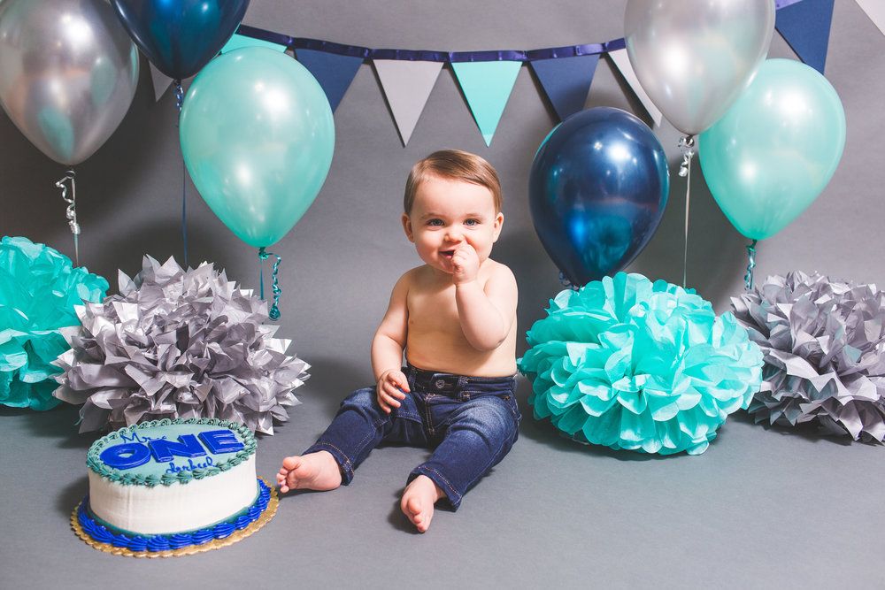 Newborn and Cake Smash - We care for your child just as we care for our own. Our newborn and Cake Smash sessions start at $350.