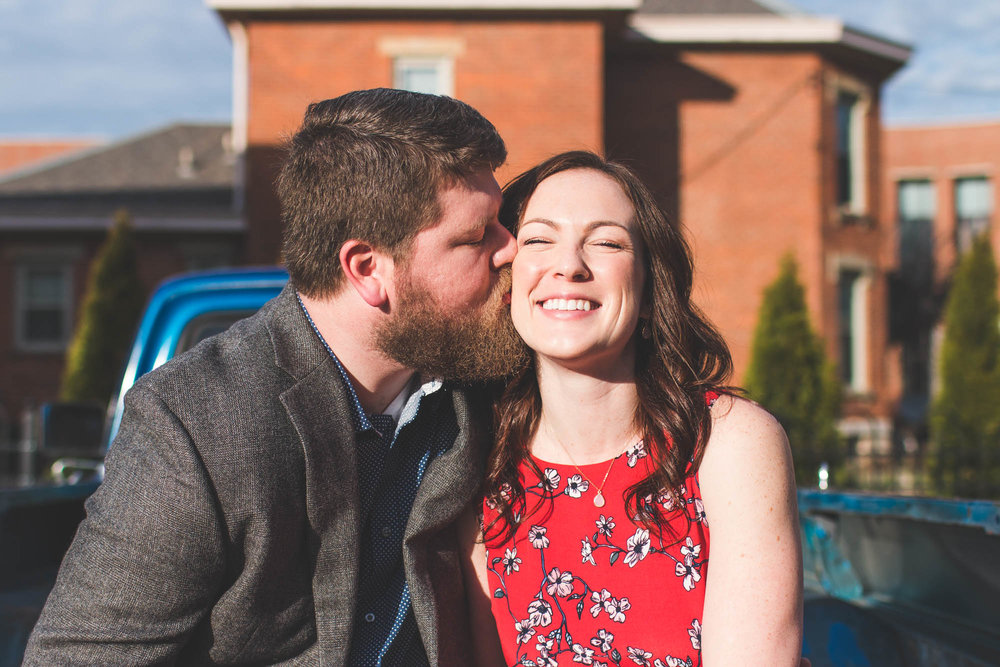 pickup truck engagement outside red floral dress