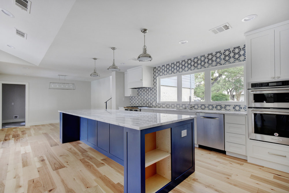Modern Farmhouse Kitchen with blue island