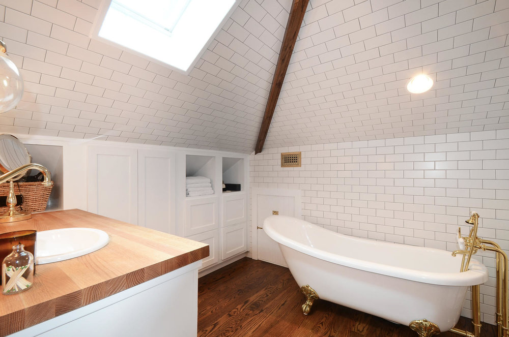 Bathroom Remodel with clawfoot tub and white subway tile