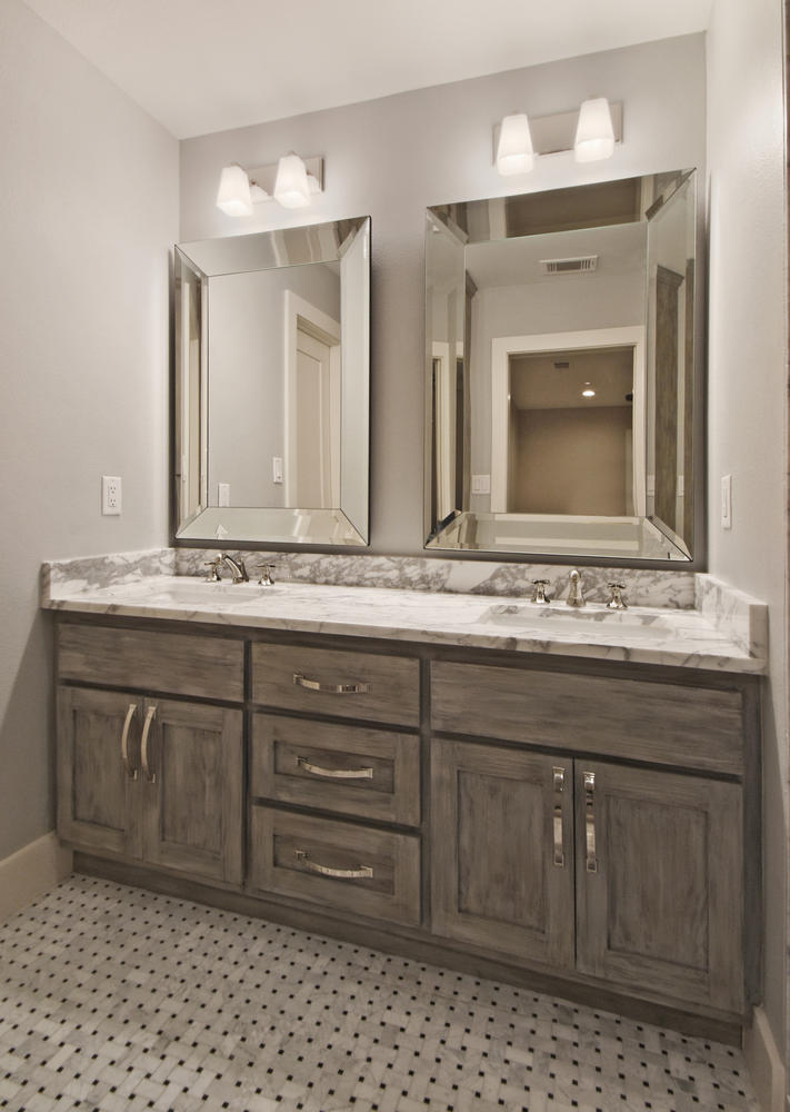 stained wood custom vanity with dual sinks