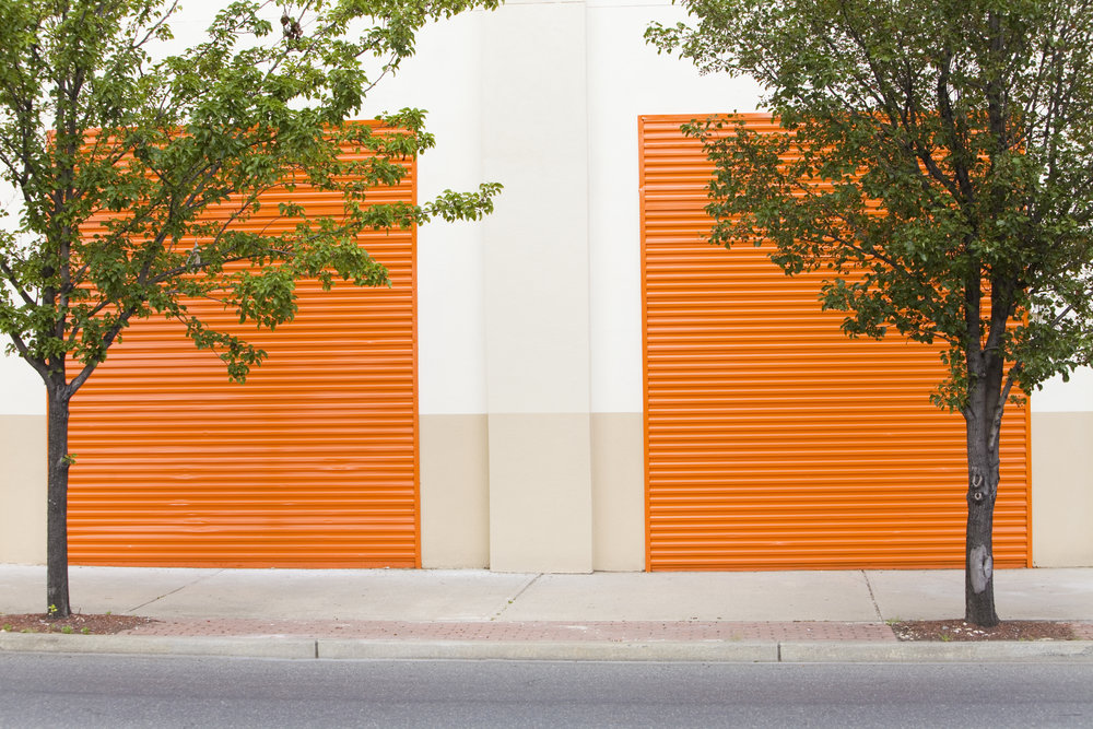 Self storage business plan and feasibility study orange doors to a self storage facility | Self Storage Ninjas