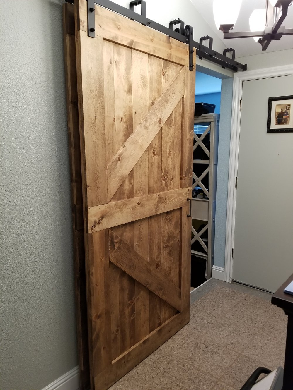 Barn Doors - Whether its for a door to the Master Bathroom, the Closet or anywhere else in your house, a barn door completes the look for wherever you want it in you house. We provide, our clients, with both painted doors and stained doors to fit any design of the home.