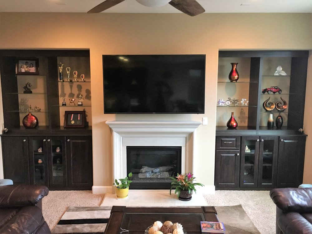 Entertainment Center - Whether its for hiding cords, displaying awards or having all your equipment stored away, an entertainment center is the perfect item to complete the room. Whatever the occasion calls for, we will create perfect Entertainment Center.