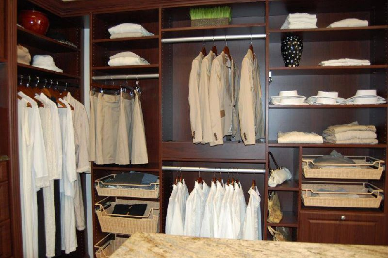 Custom Closets - We provide our clients custom closets that are tailored to their specific needs.  Every design is specific to our client's wants and needs to maximize the space they have available for storage and hanging items. The options are limitless to create your dream closet.