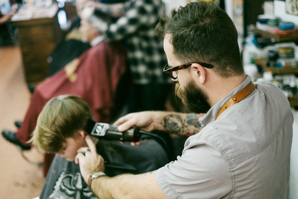 hairdresser-preparing-to-cut-customers-long-hair-in-salon-579980845-57bca9495f9b58cdfdacb68f.jpg