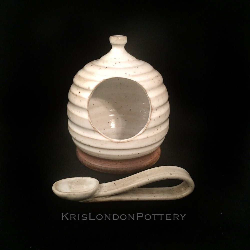 Salt pig : keep your sea salt in this handmade salt pig. great for any cook who likes to keep his or her seasoning close at hand. this piece would make a wonderful gift or beautiful addition to your home. completely handmade is the usa. thrown. on the potter wheel and altered. food safe.  white