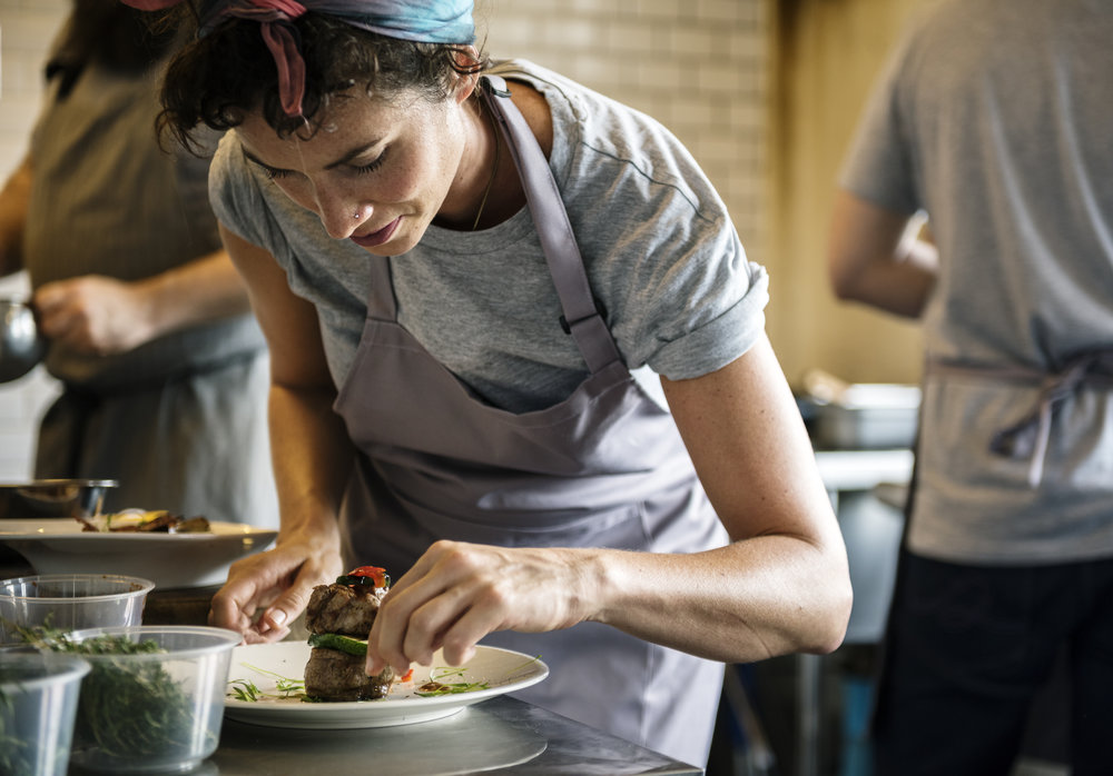 woman with apron plating food.jpg