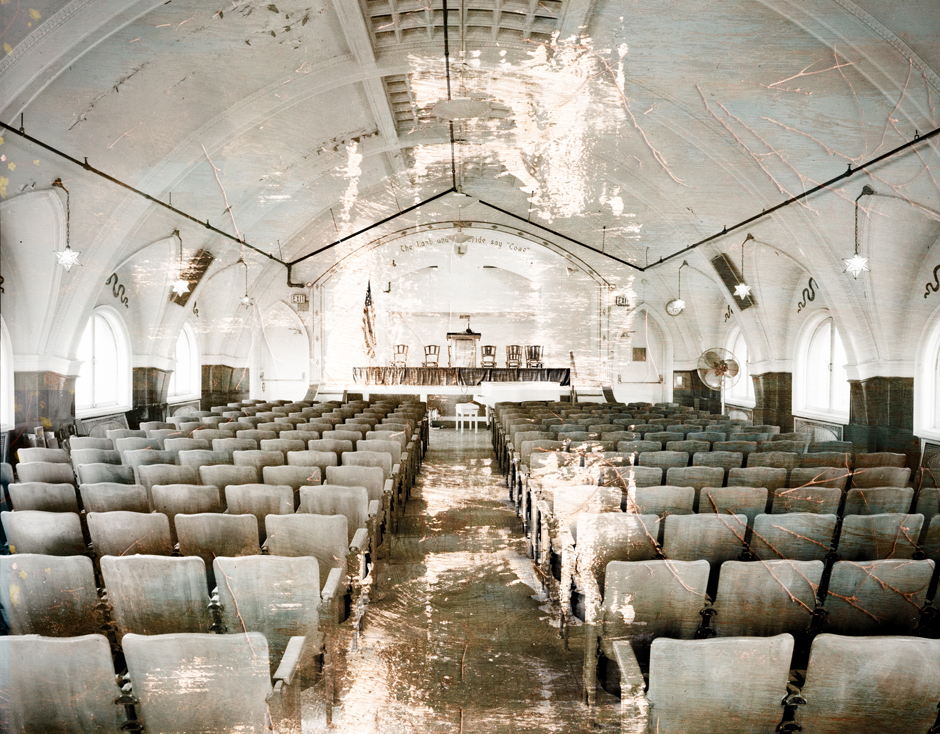 """""""Major Jealous"""" was inspired by the salvaged seats from Reverend Major Jealous """"Father"""" Divine's former chapel atop the Divine Lorraine Hotel at Broad and Fairmount Streets. The archival image at the work's core dates to the late 1980s."""