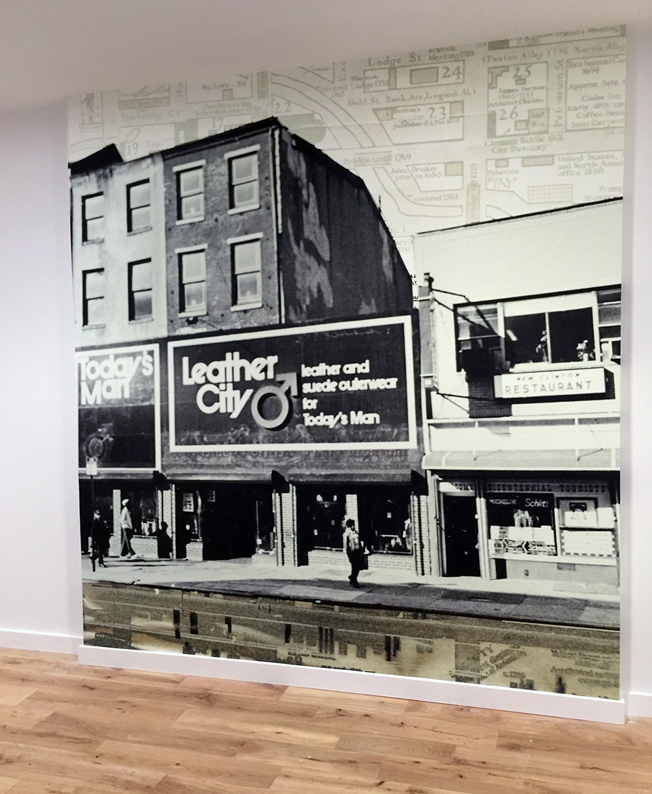 A custom photographic commission using historic photographs of  the Shirt Corner  for the wall opposite the elevator. Each floor received a unique design.