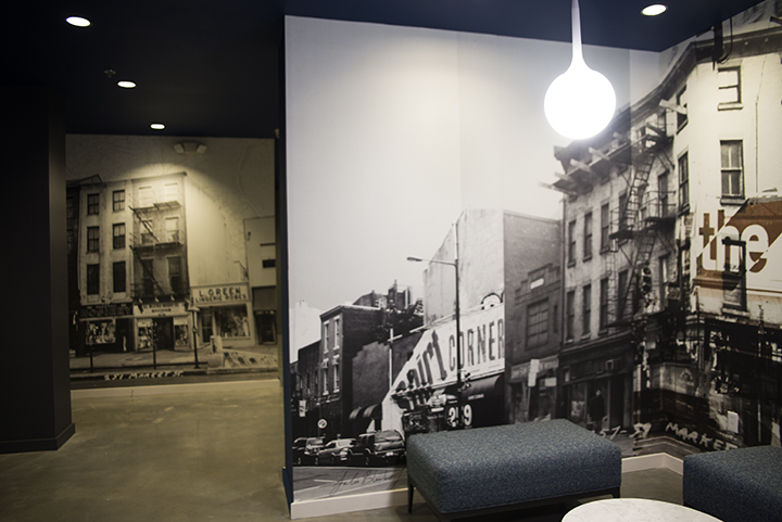 """Julia  Blaukopf on her artist concept: """"I worked with photographs that  depict  the corner during three separate time periods, spanning from the  mid  19th century to the present. My goal was to preserve the evocative   nature inherent in the original images, while at the same time   re-imagining the separate time periods into one cohesive, contemporary   design."""""""