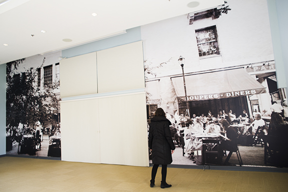 Julia first photographed cafes in Philadelphia. She then worked with   The Print Center  and Joslyn Ewart at The Towers Club to choose the final piece -- a photograph of a French restaurant on which Julia applied layers of photographs.