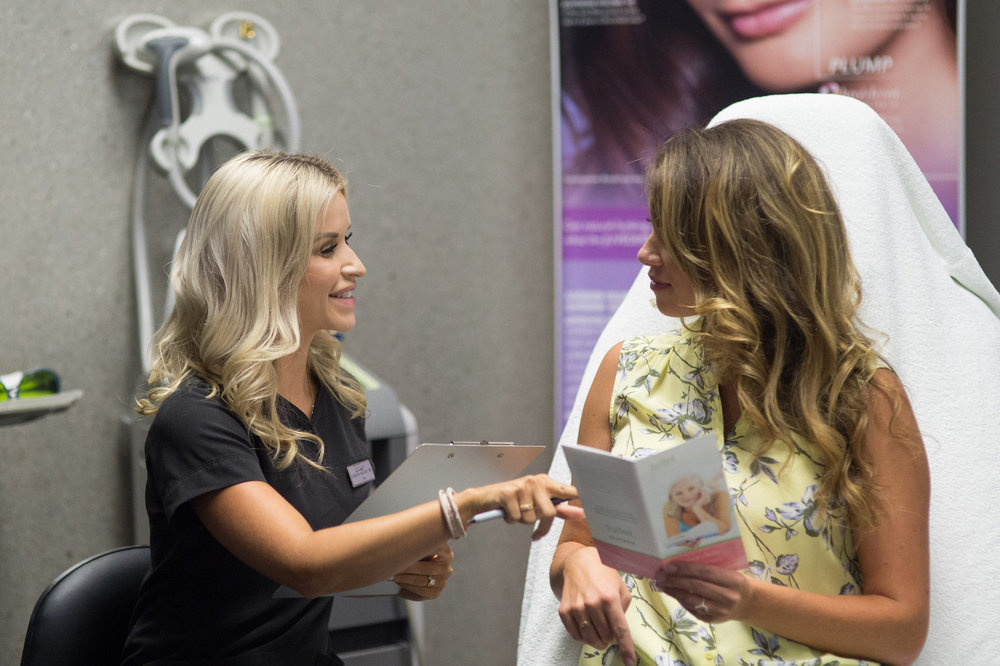 Patient receiving treatment at a Live CoolSculpting Demonstration.