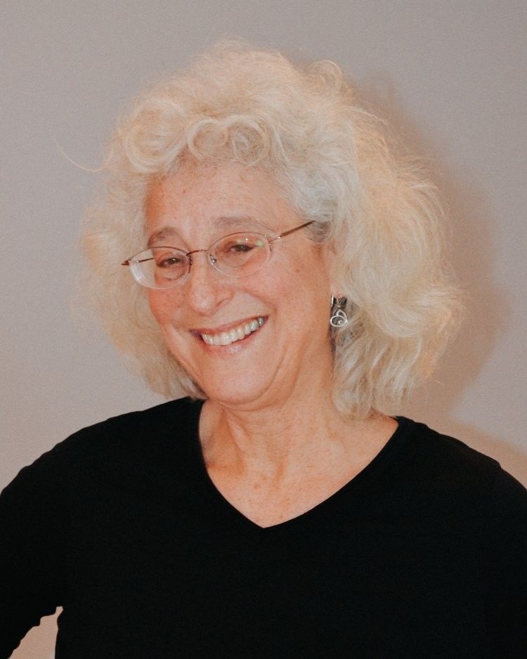 """DEB KLEIN   BA, AAS, LPTA, AYT-L1, RYT-500   Deb took her first yoga class at age 19 and began teaching in 2007. She has used yoga to manage her life at all levels. """"It is through the Satyananda Yoga experiences,"""" she says, """"especially the Yogic Studies programs, that I have found answers to many of the questions that I had so many years ago.""""  Deb has successfully used yoga to heal debilitating back and hip pain and slow the progression of arthritis. But the most profound benefits she has noticed have been a blossoming of mental and emotional strength. She notes she has less depression, more self-acceptance, more vitality and a greater ability to tackle the challenges of life.  Fun fact: I visited Leningrad during White Nights."""