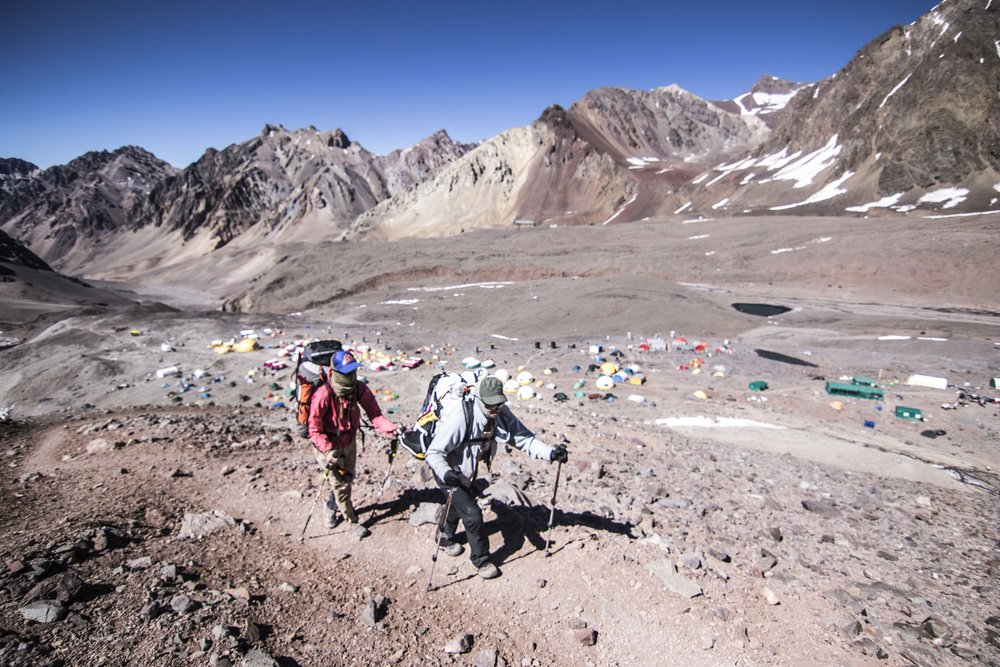 Up is optional, down is mandatory. Libby and Teresa carrying loads above basecamp.