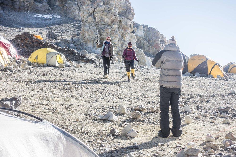 Tara greeting Kristin and Karin back in high camp
