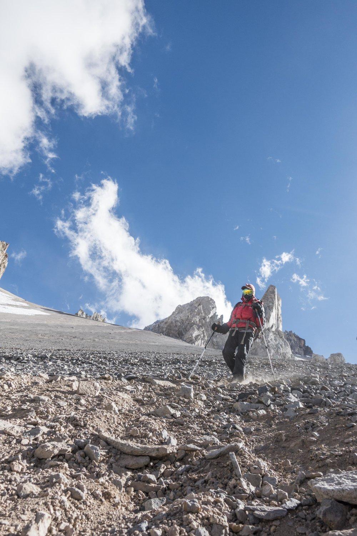 Kristin descending Aconcagua's characteristic steep scree