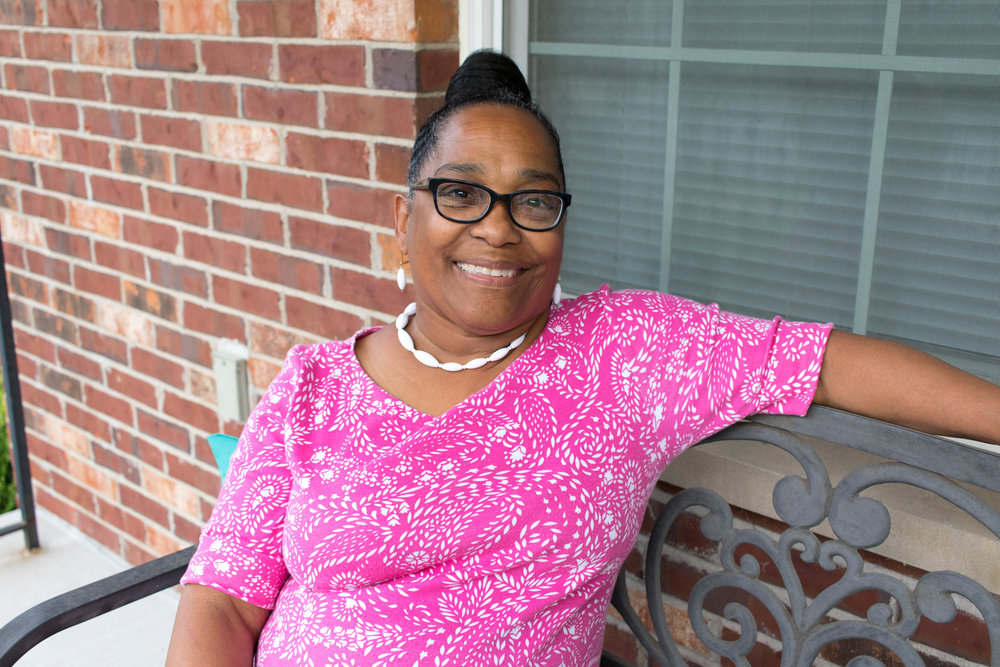 Janet Roberson is a board member of Northside Community Housing and a recent graduate of WEPOWER's Power-Building Academy. She is pictured here on her front porch in The Ville neighborhood. Photo by Kristen Trudo.