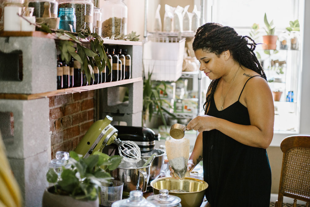 La'Crassia Wilderness, founder of Butter Love by L.C., holds a jar of her handmade body butter. Photo by Abby Gillardi.