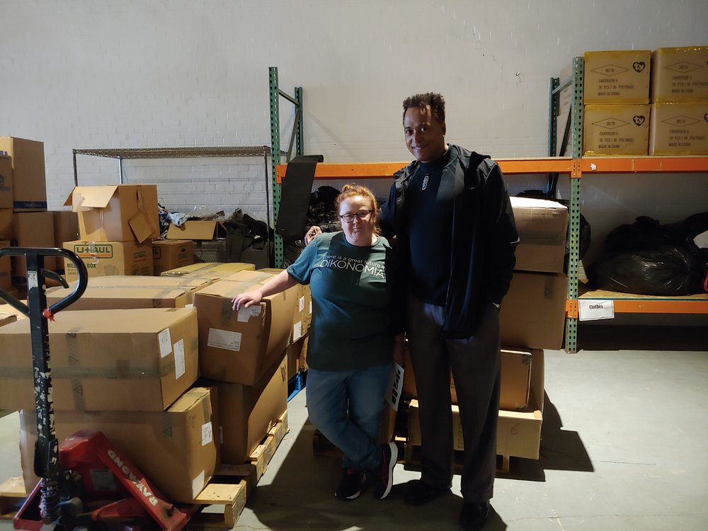 Pictured left to right (Candace Emery, Donations Director, D Newkirk, Community Outreach Manager)