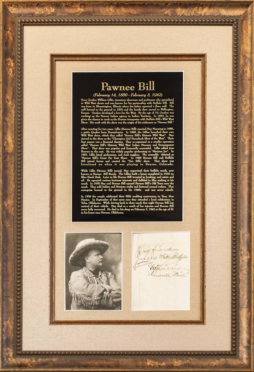 Pawnee Bill with a custom engraved  black and gold metal plaque