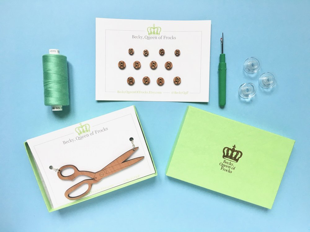 Cheeky buttons and a necklace in the shape of a pair of scissors? You know it! BeckyQoF gift set.