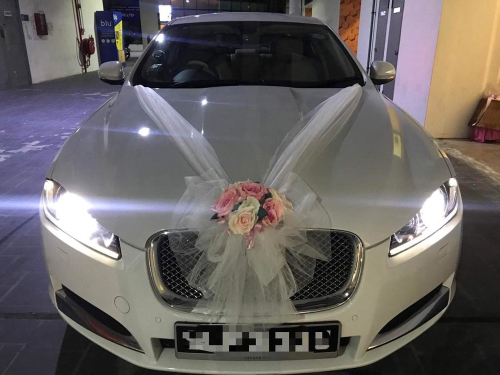 jaguar xf wedding car with decorations package