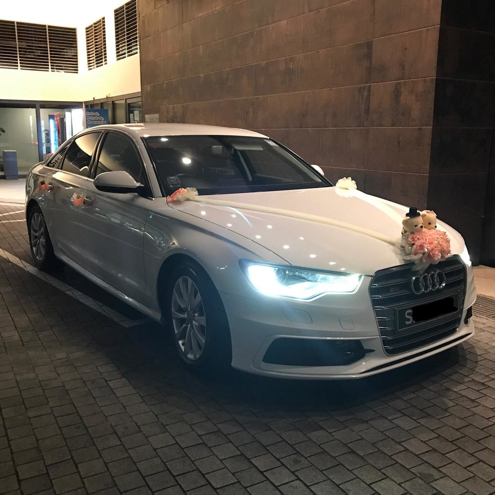 Audi A6 wedding car at night