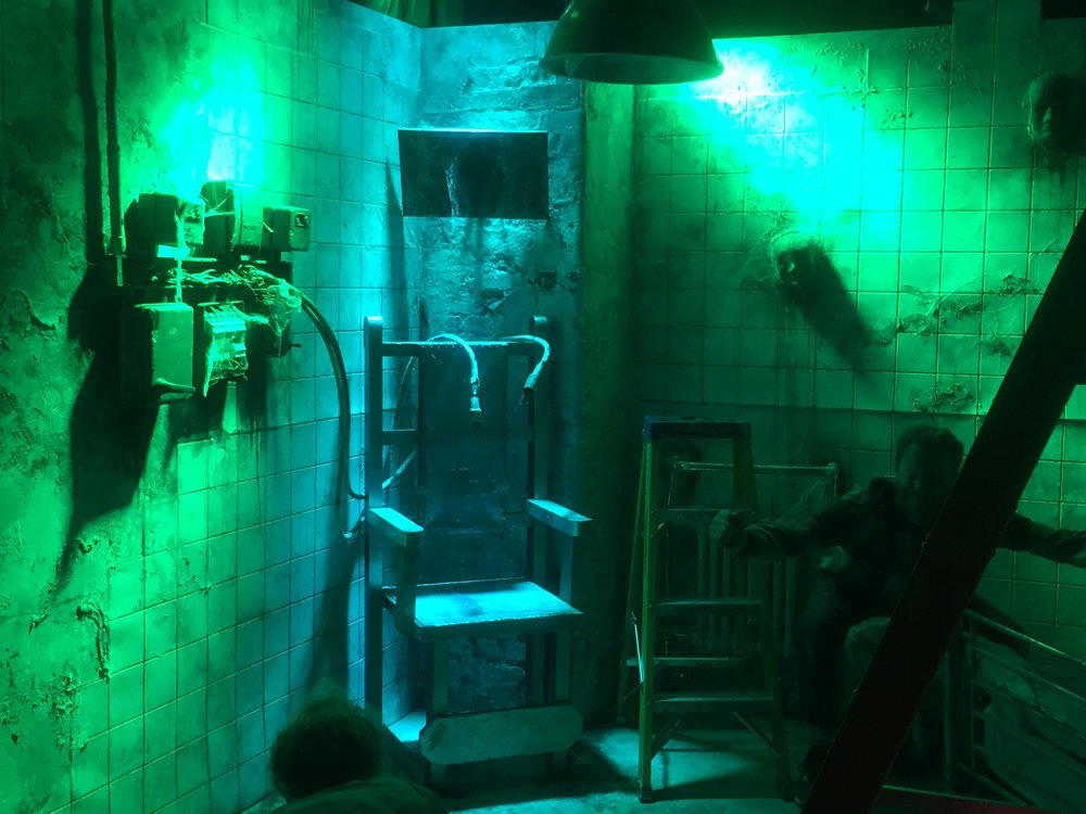 Electric chair lit in blue and green