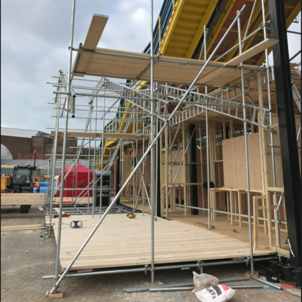 scaffoling and wood/ start of a building project.