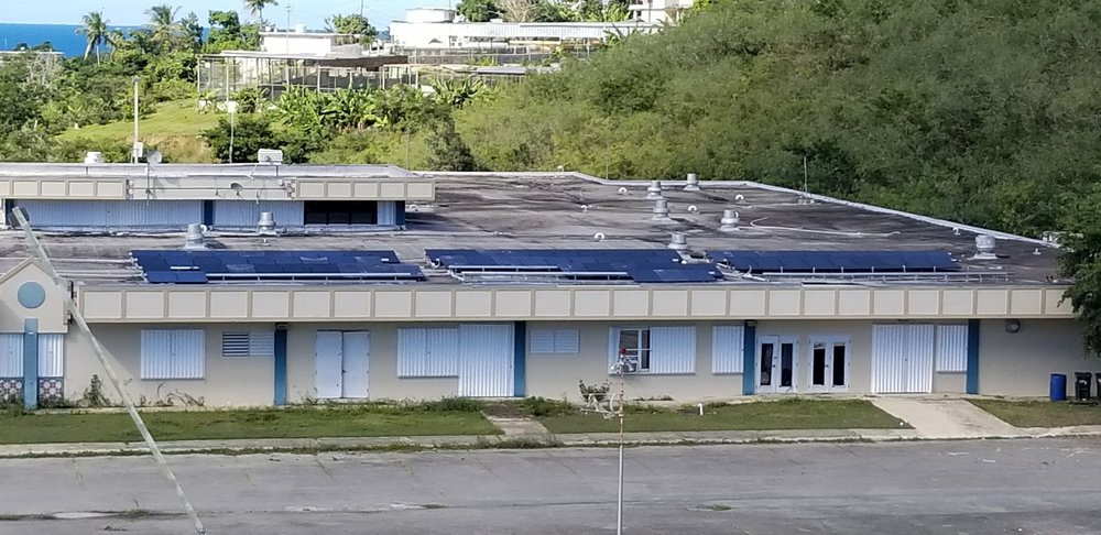 tesla solar panels on the roof of the hospital in vieques, now closed due to black mold