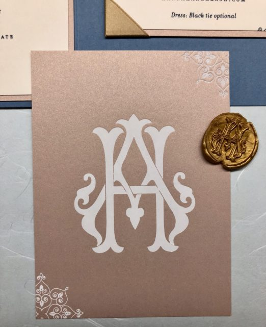 Dusty blue and gold wedding suite with vellum overlay and monogram gold wax seal