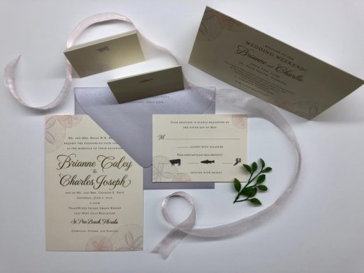 Beach motif wedding stationery with sand dollars and lavender envelope