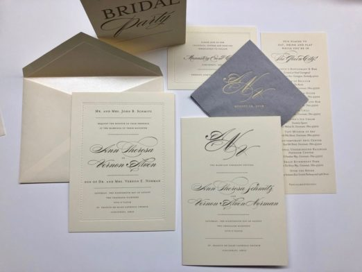 Elegant cream wedding invitation with beaded border and custom monogram
