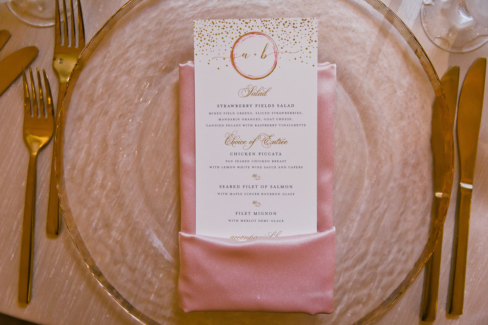 Blush and gold wedding dinner menu with monogram by Poeme