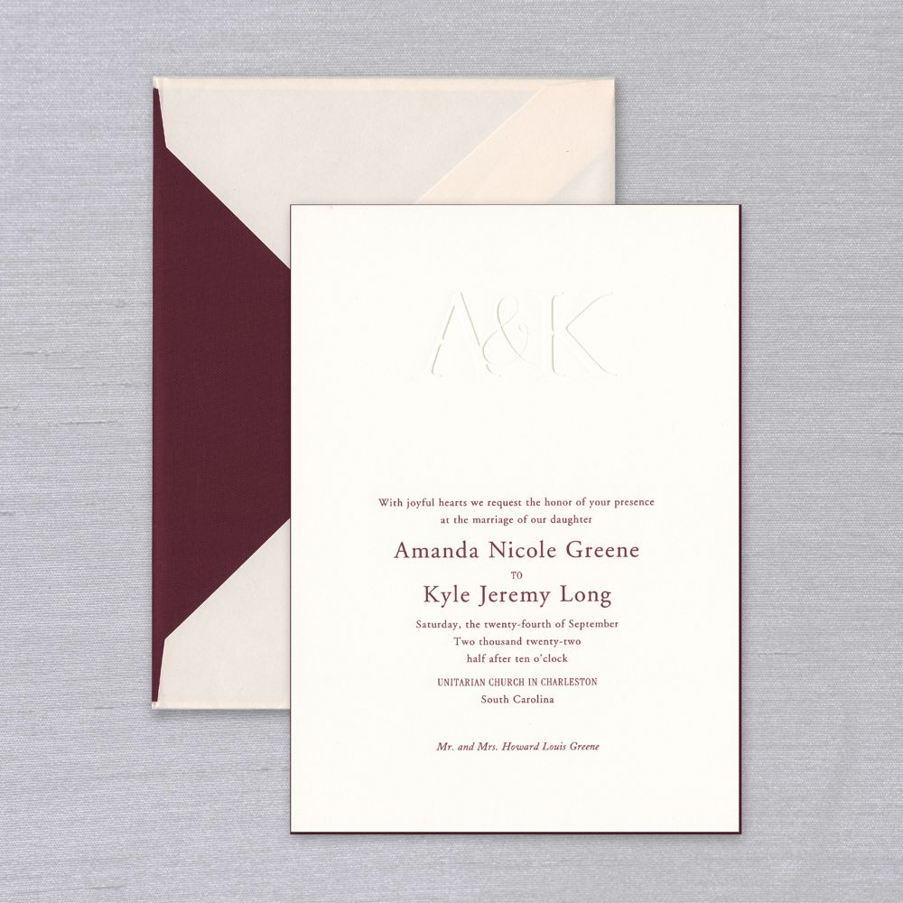Vera Wang Delaney Wedding Invitation   Bold yet romantic, the Vera Wang Delaney Wedding Invitation features blind embossed initials atop prettily engraved text, shown in a lush merlot. A striking merlot painted edge (optional) ties this striking look together. Each invitation comes with a coordinating blush colored envelope, shown here with a luxurious merlot taffeta fabric liner. Corresponding response set and reception cards are available while personalizing for an additional charge. The Vera Wang Delaney Suite includes a personalized note card for all your post nuptial thank yous.