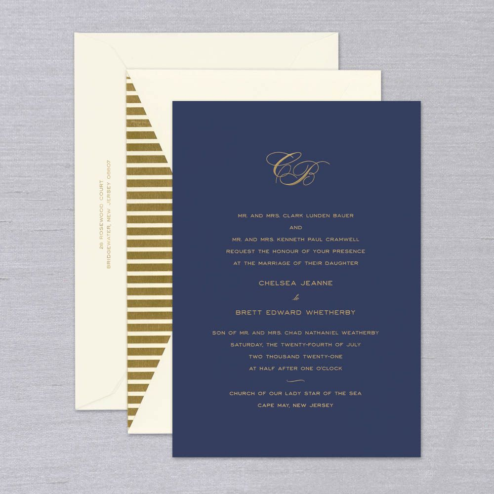 Newport Wedding Invitation   Perfect mix of classic and contemporary. Matching timeless design with a modern aesthetic, the invitation melds script, bold type and a delicate monogram for a look and feel that's altogether stunning. Shown with luxe gold type on Navy Kid finish, the Newport will be a chic first look at your big day to come. Each invitation comes with coordinating ecru inner and outer envelope. Inner envelope shown here with a gold stripe liner. Corresponding ecru response and navy reception cards are available while personalizing for an additional charge.