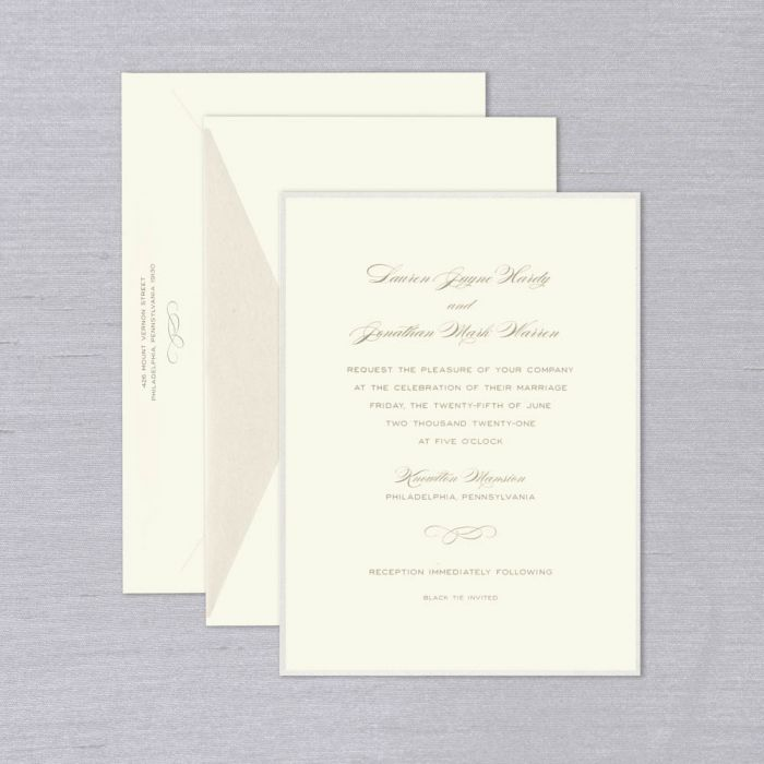Emma Wedding Invitation   The Emma Wedding Invitation, with its delicate pearlescent border, will be an utterly charming first glimpse at the wedding day that awaits. Full of character, it features a mix of sweeping script and bold type, shown here in pewter grey. Each invitation comes with coordinating inner & outer envelopes, shown with champagne shimmer lining. Corresponding response set & reception cards available while personalizing for an additional charge.