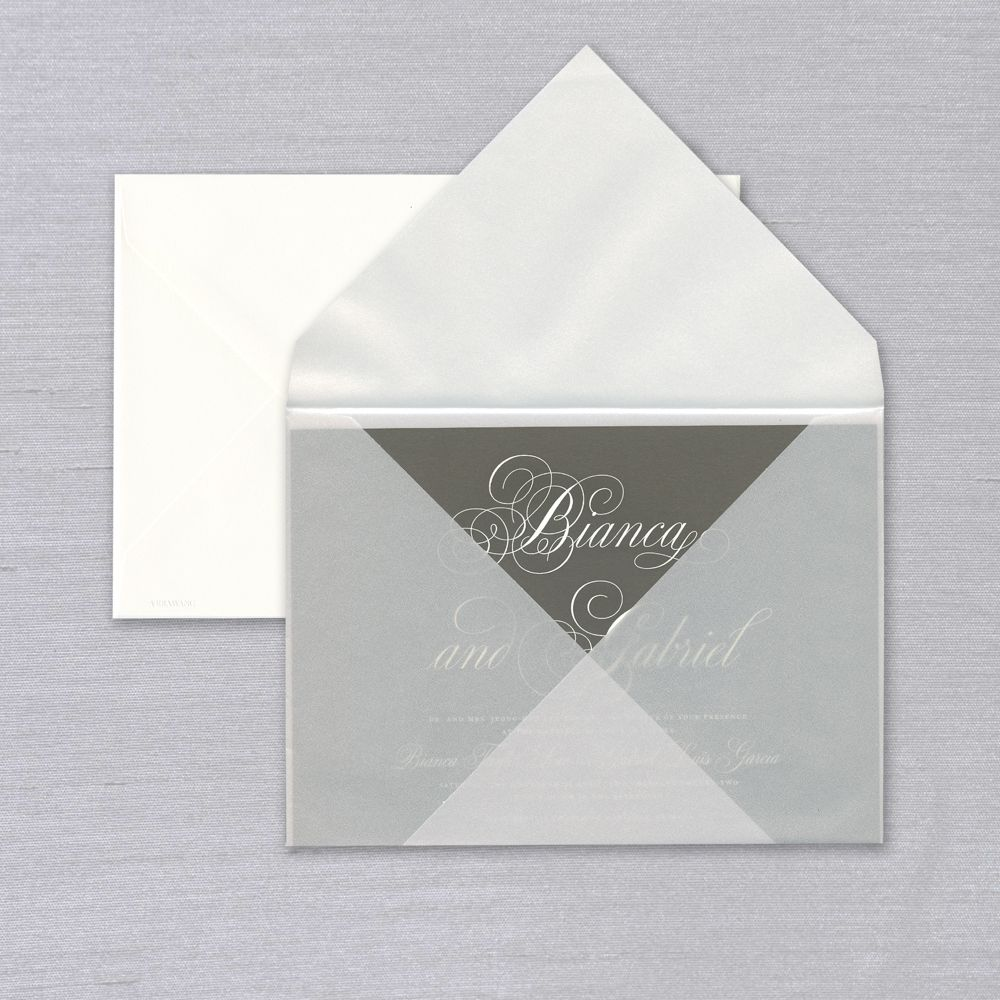 Vera Wang Pewter and Pearl Wedding Invitation    Beautiful, illustrious script is the highlight of this sophisticated invitation, featuring engraved type shown in oyster ink on a pewter card. Each invitation comes with a striking pearl vellum inner envelope and coordinating oyster outer envelope. Please note the Vellum inner envelope shown is intended for an elegant presentation only and requires an outer envelope for mailing. Corresponding response set and reception cards are available while personalizing for an additional charge. The Pewter and Pearl Suite also includes a coordinating Menu card.