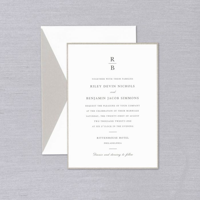 Revere Wedding Invitation   The Revere Wedding Invitation's sleek monogram and refined type shown in charcoal ink perfectly complement the silver-hued frame, a delightful and distinctive detail that will live before, during and after your big day. Each Invitation comes with a coordinating envelope, shown here with a silver lustre liner. Corresponding response sets are available while personalizing for an additional charge.